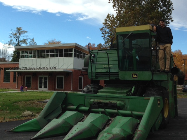 Here's our organic farming coordinator, Matt, and his combine gearing up to head up the hill to some of our fields.